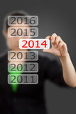 Screen button with 2014 number on hand. Stock Image