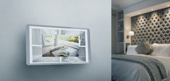 Composite image of screen of digital tablet. Screen of digital tablet against illuminated neat bedroom Stock Images