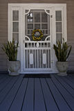 Screen door on front porch Royalty Free Stock Images