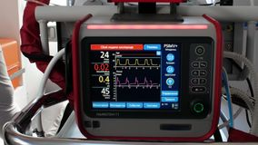 The screen of the electrocardiograph is connected to a newborn premature baby. Ambulance car transports premature baby. hd. hd vid stock footage