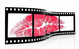 Screen Kiss. Old grainy filmstrip with lipstick kiss Stock Photography