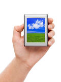 Screen with landscape in hand Royalty Free Stock Photo