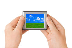 Screen with landscape in hands Royalty Free Stock Image