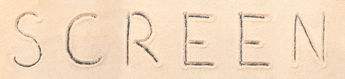 Screen lettering drawn on sand Royalty Free Stock Image