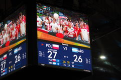 Screen at Maracanazinho during Rio2016 Olympics. Screen at Maracanazinho, an indoor arena used for Olympic  Volleyball games, showing Polish fans cheering Royalty Free Stock Photography