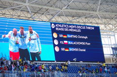 Screen with Olympic medalist of men`s discus throw at Rio2016 Olympics. German Christoph Harting with gold medal, Polish Piotr Malachowski with silver medal Royalty Free Stock Images