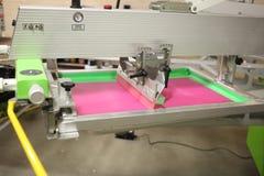 Screen on a screen printer. Pink screen on a screen printer stock photos