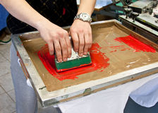 Screen printing. Manual screen printing - hand printing t-shirts royalty free stock photos