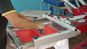 Screen printing manufacturing on t-shirts stock video footage