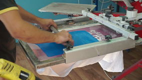Screen printing manufacturing on t-shirts stock video