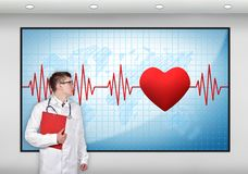 Screen with pulse symbol. Doctor with clipboard looking to screen with pulse symbol Royalty Free Stock Image
