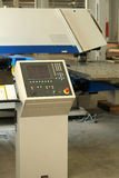 Screen of punching machine. In metal construction factory stock image