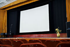 Screen and scene in movie theater Stock Images
