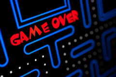 Screen showing that the Game is Over. Macro picture of a video game Stock Photos