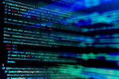 Screen with software developer code. Blur lights. Stock Image
