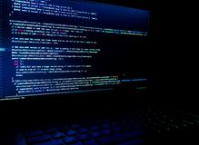 Screen with software developer code. Blur lights. Royalty Free Stock Image
