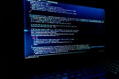 Screen with software developer code. Blur lights. Stock Images