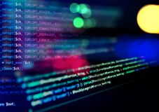 Screen with software developer code. Blur lights. Royalty Free Stock Photo