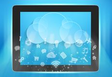 On the screen of tablet cloud and icons. Royalty Free Stock Photography