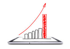 On the screen of the tablet is a growth graph Royalty Free Stock Image