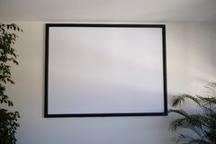 Screen for video projector in the meeting room. White stock image