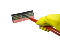 Screen wiper. The hand in a yellow rubber glove holds a screen wiper. On a white background Royalty Free Stock Photography