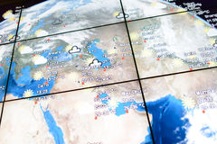 Screen with world map in airport Stock Photo