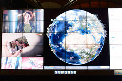 Screen with world map in airport Stock Photography