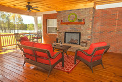 Screened Backyard Deck. Screened in backyard deck with furniture overlooking lake Stock Photo