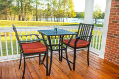 Screened in Deck. Screened in backyard deck with furniture overlooking lake Royalty Free Stock Photography