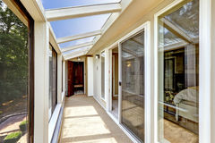 Screened deck with glass roof. Bright screened deck with carpet floor and glass roof. Entrance to bedroom Stock Image