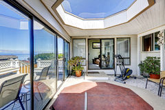 Screened deck with jacuzzi, exercise equipment and skylihgt. Bright screened deck with jacuzzi and big skylight. Exit to walkout deck Royalty Free Stock Photo