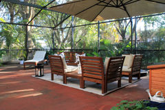 Screened-in patio in Florida. Screened-in residential outdoor patio in Miami suburbs, Florida Royalty Free Stock Photography