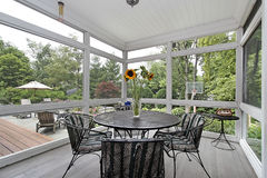 Screened in porch. With table and wood floor Stock Photo