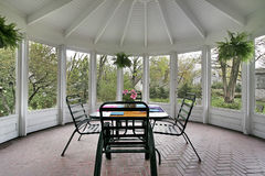 Screened in porch. With table and brick floor Stock Photo