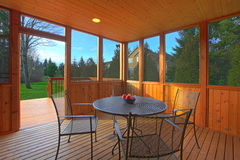 Screened porch with a dining table set Stock Photos