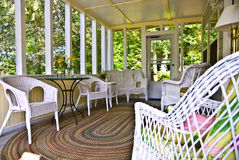 Screened Porch with White Wicker stock images