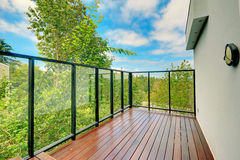 Screened walkout deck with wooden floor.  Stock Photography