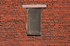 Screened window. On brick wall Royalty Free Stock Images