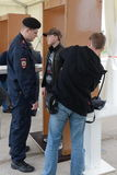 Screening of visitors at the International aviation and space salon MAKS-2013. The job of the police. Stock Photo