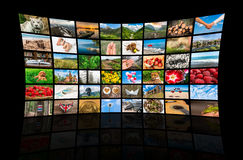 Screens forming a big multimedia broadcast video wall Royalty Free Stock Photography