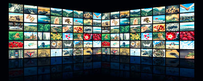 Screens forming a big multimedia broadcast video wall. Retro style royalty free stock photos