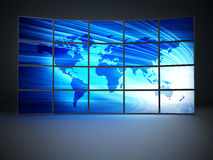 Screens forming video wall. Screens with a blue world map forming video wall Royalty Free Stock Photography
