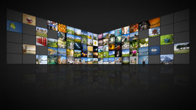 100 screens video wall. A futuristic video wall with 100 screens Stock Photography