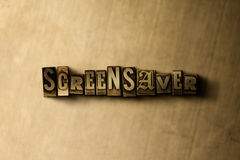 SCREENSAVER - close-up of grungy vintage typeset word on metal backdrop Stock Image