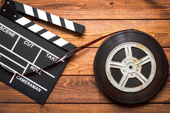 Screenwriter desktop with movie clapper board wooden background top view Stock Images