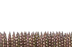Screw background. Close-up of golden screws as technology background Royalty Free Stock Photos