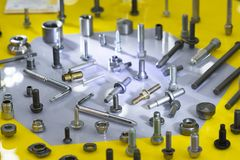 Screw on blue background. Industirial screw and bolt manyfacturing royalty free stock photos