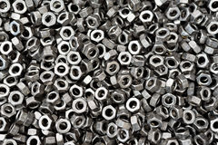 Screw, bolt and nut in black and white for industrial background. Small screw, bolt and nut in black and white for industrial background Stock Images