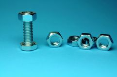 Screw and bolts. In a blue background Stock Image